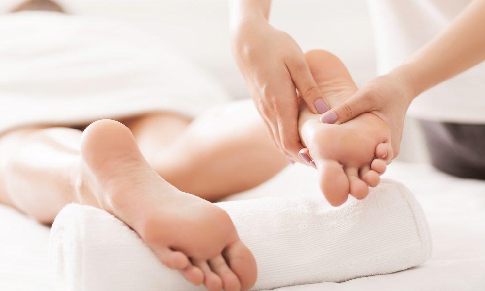 acupressure-and-reflexology-concept-masseur-doing-foot-massage.jpg