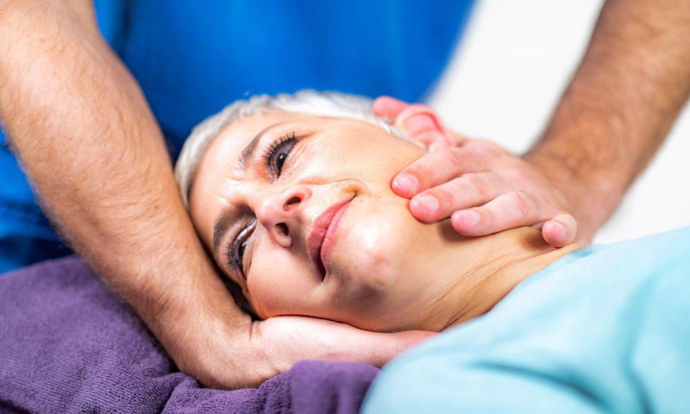 physical-therapist-stretching-senior-woman-s-neck.jpg