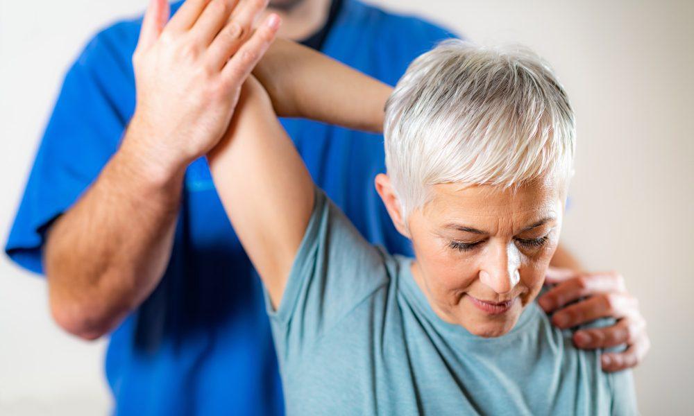 therapist-checking-senior-woman-s-arm.jpg